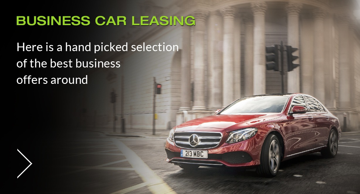 A red Mercedes-Benz Special offer lease car driving through a city